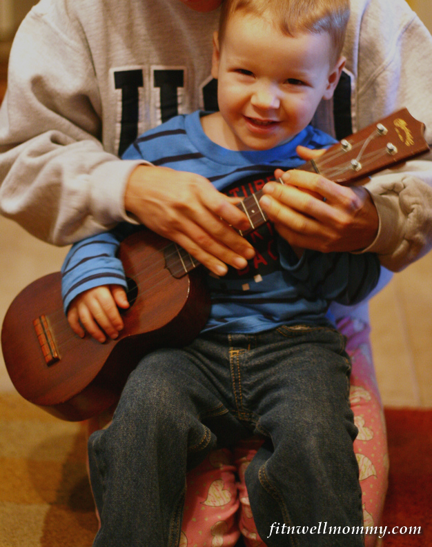Happy to see that Santa brought him his very own guitar for Christmas!