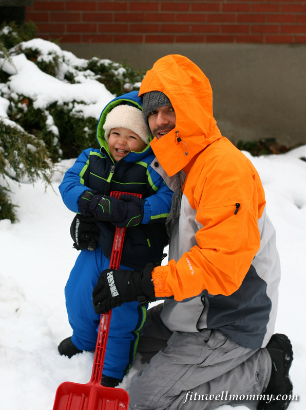 Keenan shoveling snow with Uncle E!