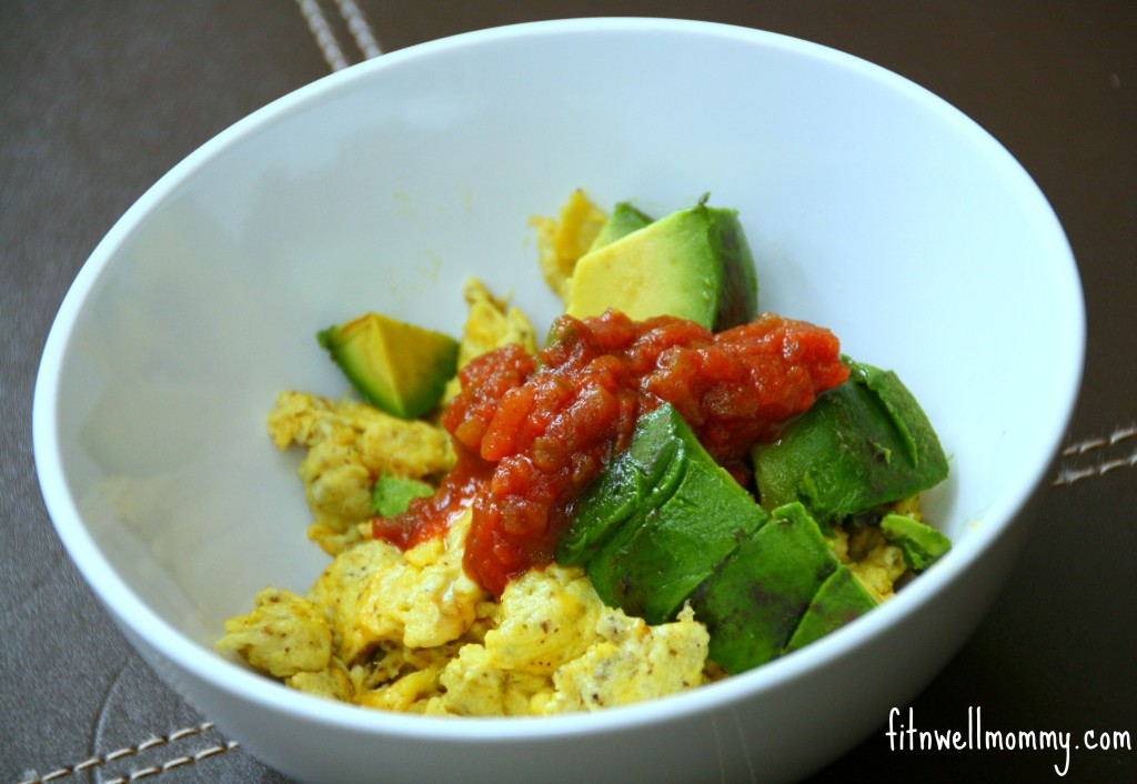 Scrambled eggs with cheese, avocado and salsa